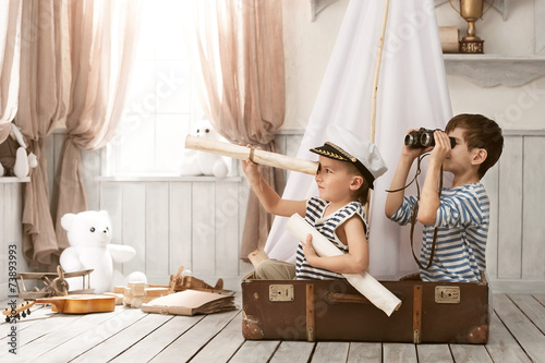 Fotografia  Boys in the image of sailors playing in her room