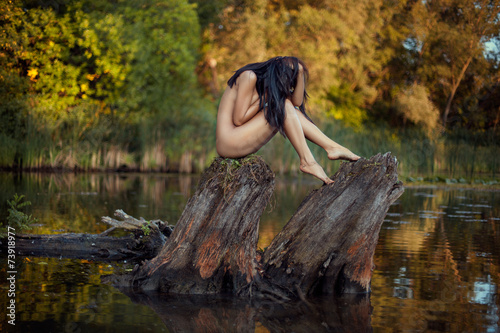 Foto auf Leinwand Fantasie-Landschaft Naked girl on the lake.