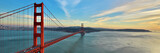 Golden Gate Bridge panorama, San Francisco California, sunset light on cloudy sky