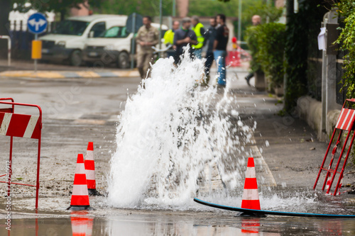 Obraz road spurt water beside traffic cones - fototapety do salonu