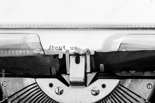 """Photo  Typewriter with the """"About us"""" text typed on a paper"""
