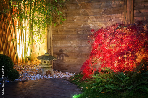 Japanese  zen garden lightened by spot lights at night