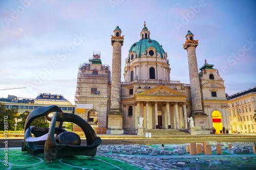 Photo Stands Vienna St. Charles's Church (Karlskirche) in Vienna, Austria