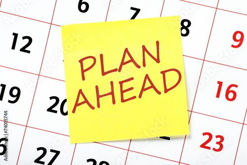 Obraz na plátne The phrase Plan Ahead written on a yellow sticky note