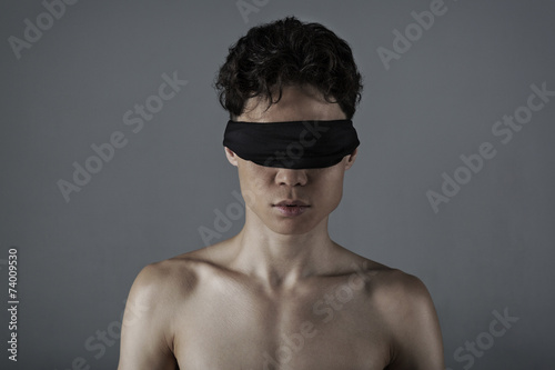 Fotografie, Obraz  Young man  with a blindfold