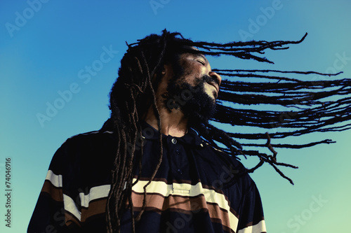 "Happy man with ""windy"" dreadlocks. Caribbeans. Wallpaper Mural"