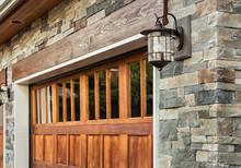 Garage Door Detail And Stone Work Of New Luxury Home
