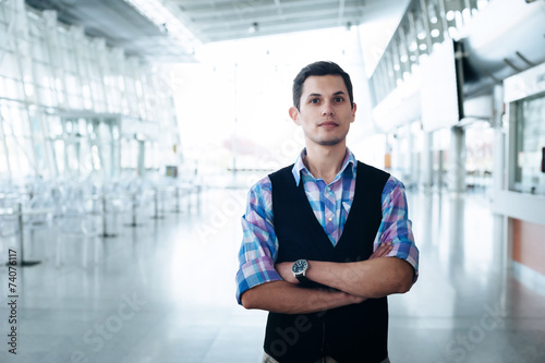 Fototapety, obrazy: Man with serious look on a background of departure board at airp