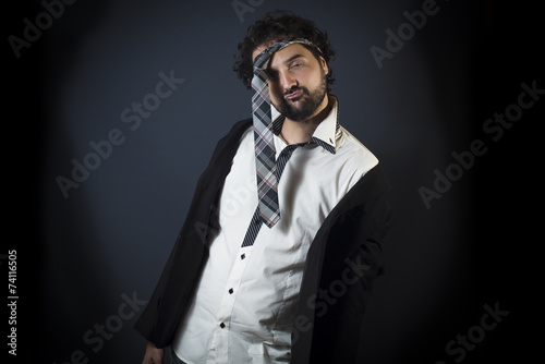 Fotografie, Obraz  Young man drunk with necktie on head