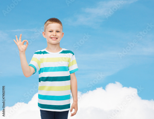 fd465b334d little boy in casual clothes making ok gesture - Buy this stock ...