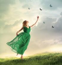 Beautiful Girl Catching Butterflies On A Mountain