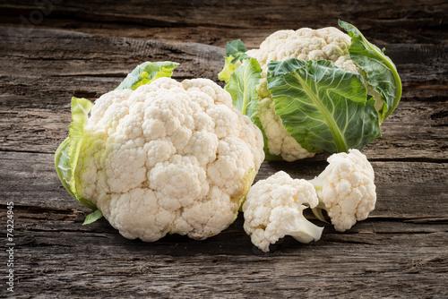 Organic cauliflower on wooden background - 74224945