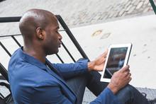 Black Guy Using Digital Tablet