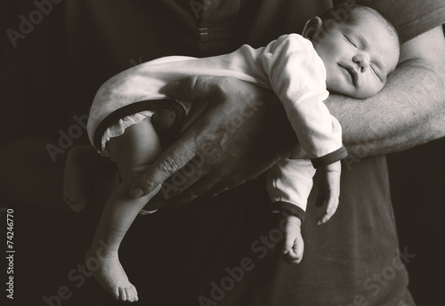 Newborn baby and his father's hand Poster