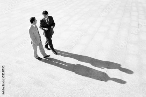 Fotografía  Hombres de Negocios proyectando sombra