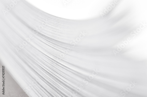 Foto bending stack of paper, a fragment of a book or magazine