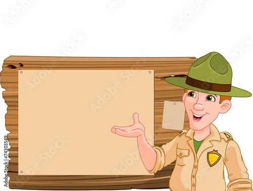 Printed kitchen splashbacks Fairytale World Ranger pointing at a wooden sign