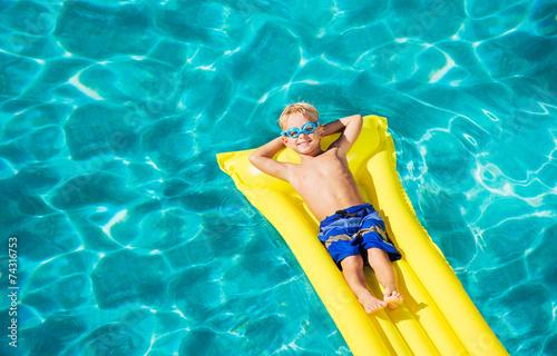 Fotografie, Obraz  Young Kid Having Fun in Swimming Pool