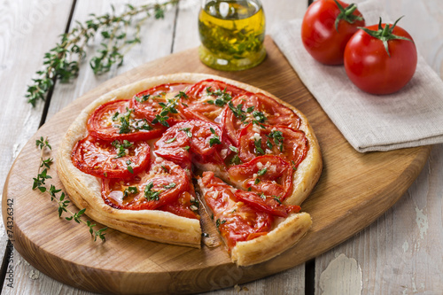 Photo  pie with tomato tart of puff pastry