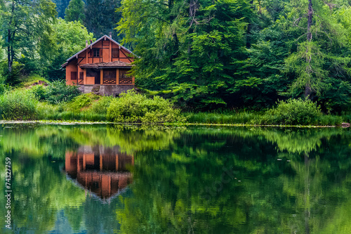 Photo  Red house on the lake