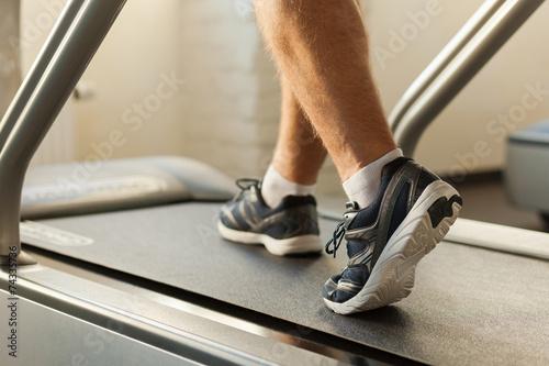 Photo Exercising on treadmill.