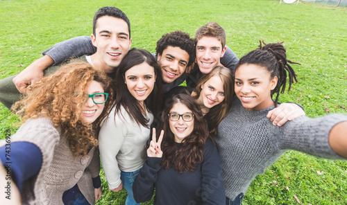 Obraz Multiethnic Group of Friends Taking Selfie at Park - fototapety do salonu
