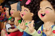 Cheerful Children's Figurine Terracotta Doll.