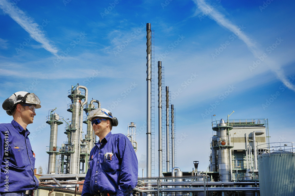 Fototapety, obrazy: oil workers in front of large chemical refinery