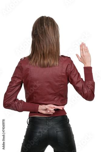 Woman with fingers crossed Fototapeta