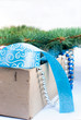 box with Christmas toys, blue and silver beads, blue ribbon and