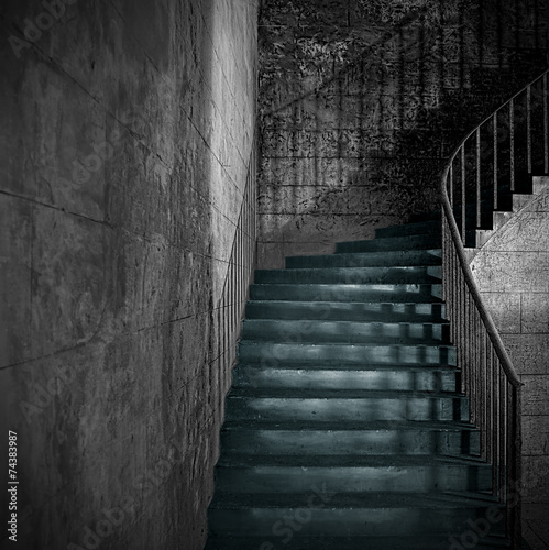 Spooky old stone interior staircase with rusty handrail