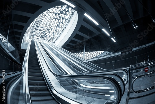 Moving escalator in the business center Poster Mural XXL