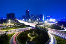 Traffic Trails And Modern Cityscape Of Beijing,china