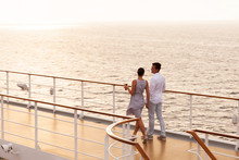 Couple Walking On Cruise Ship Deck