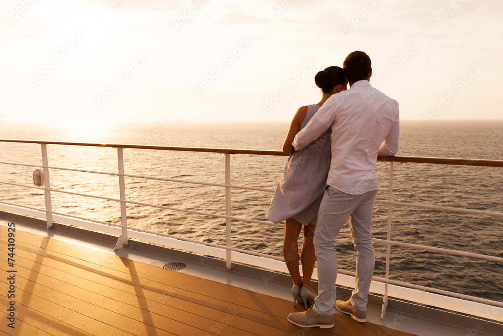 Fototapety, obrazy: young couple hugging at sunset on cruise ship