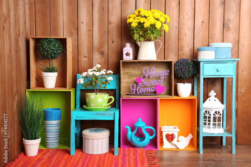 Beautiful colorful shelves with different home related objects Плакат