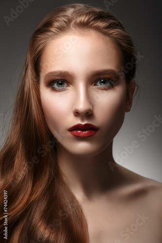 Fotografie, Obraz  beautiful woman with perfect skin and long hair on a grey backgr