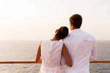 Young Couple Enjoying Sunset On Cruise