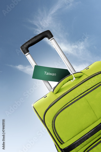 Taiwan. Green suitcase with label Slika na platnu