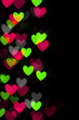 Defocused heart bokeh lights, abstract background