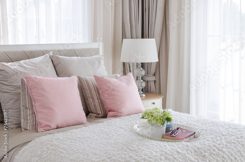Fotografia, Obraz  pink pillows on bed with tray of flower