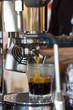 Espresso machine pouring coffee in glass