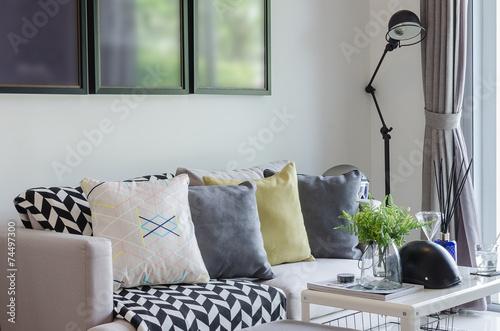 Valokuvatapetti modern living room with row of pillows on sofa