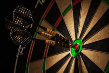 Three Darts In Bull's Eye Close Up