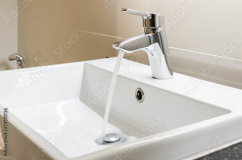 washbasin and faucet with water drop