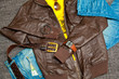 fashionable unisex outfit: leather jacket, T-shirt, jeans, belt