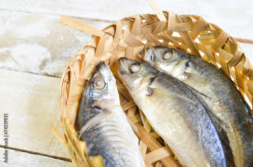 Valokuva  mackerel scads (decapterus) in bamboo basket