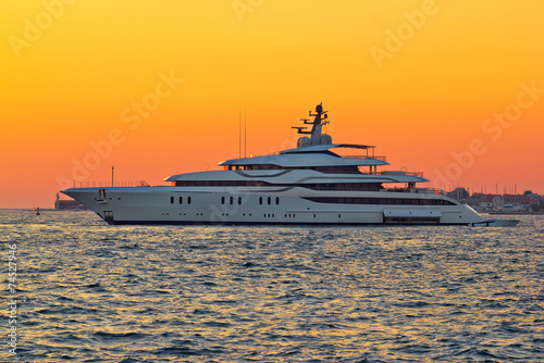 Superyacht on yellow sunset view