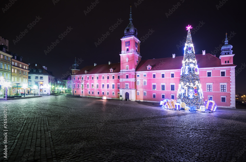 Christmas decorations on the old town of Warsaw at night.Royal C