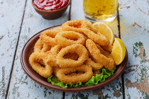 Fototapeta fried squid rings, breaded with lemon obraz